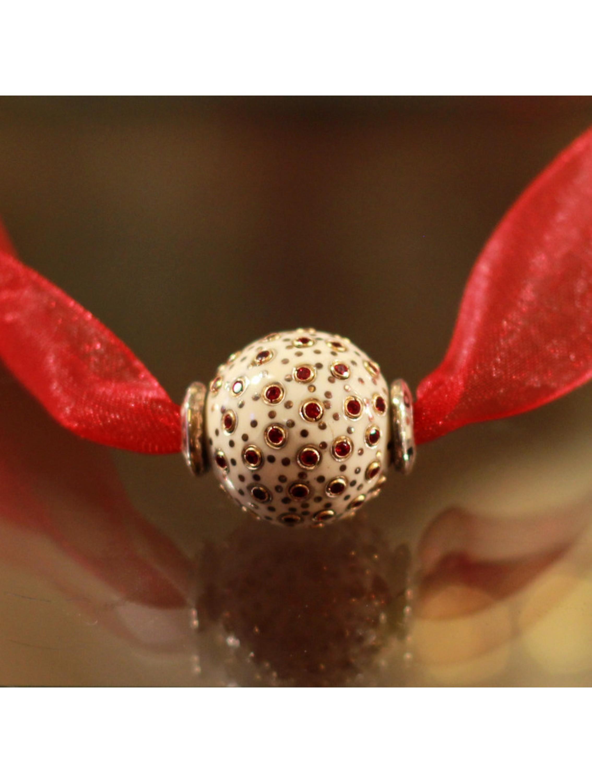Naszyjnik- kulka ozdobiona czerwonymi cyrkoniami