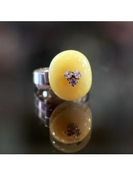Bursztynowy pierścionek z topazami